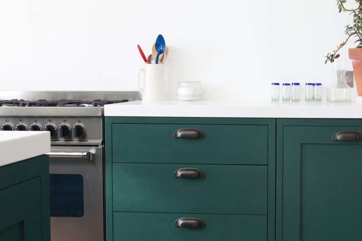 Green simple shaker kitchen with white counter tops