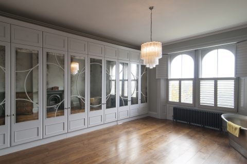 White wardrobes with art deco pattern
