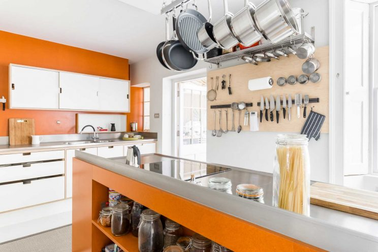 Modern minimal kitchen with orange Velchromat