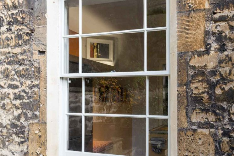 Six over six pane sash window in period style home