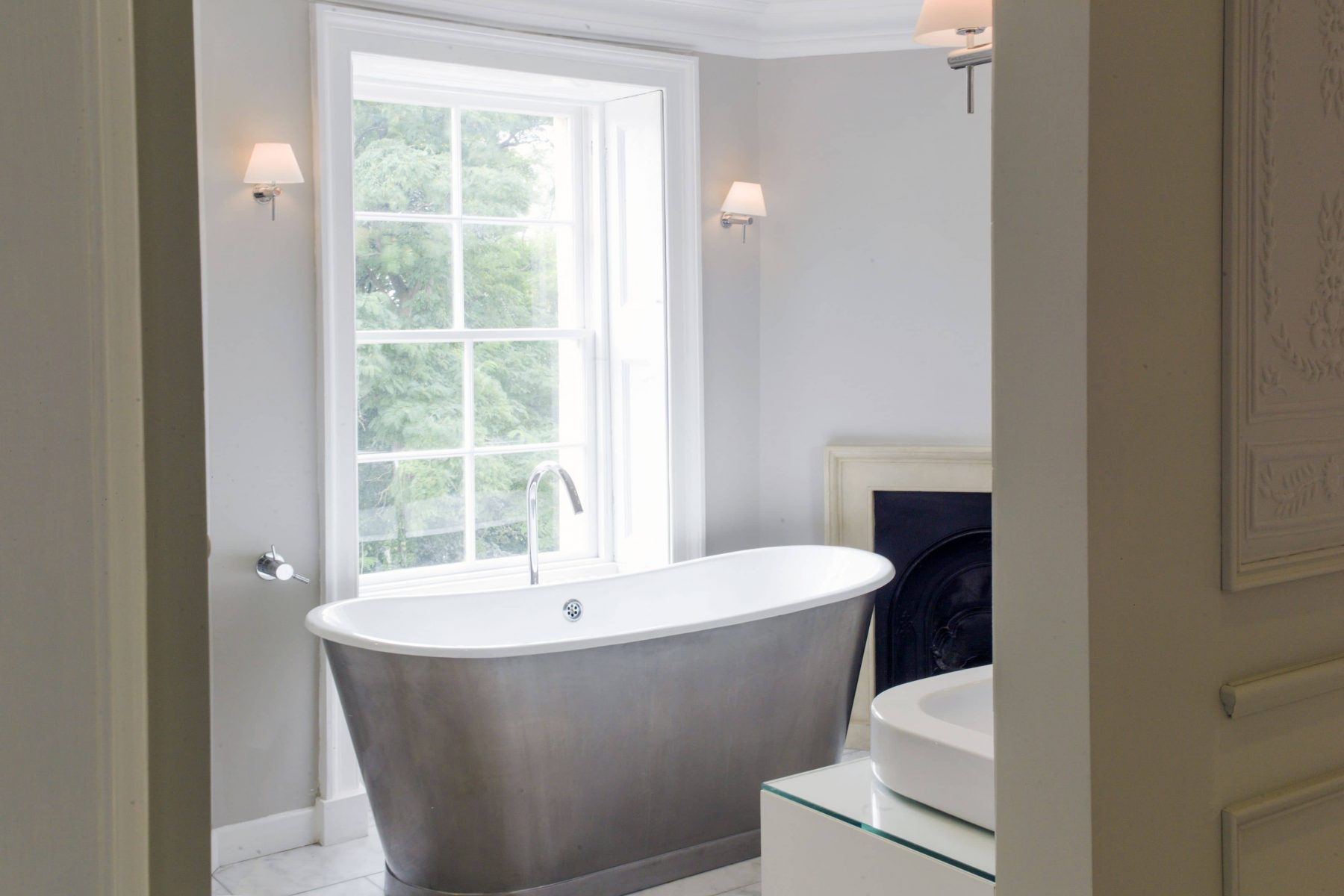 Cast iron bath tub with sash window