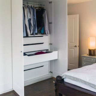 Modern white fitted wardrobe in master bedroom
