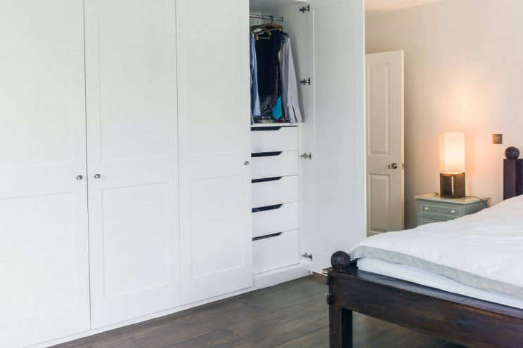 Minimalist white wardrobes with internal storage