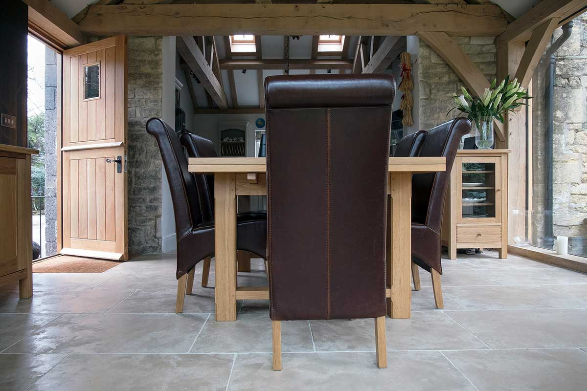 Modern dining room with leather chairs and oak dining table