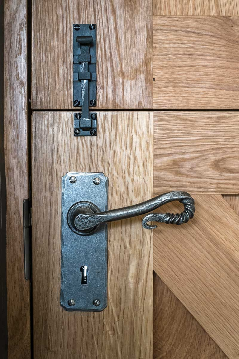 Oak door with iron latch and handle in Bath