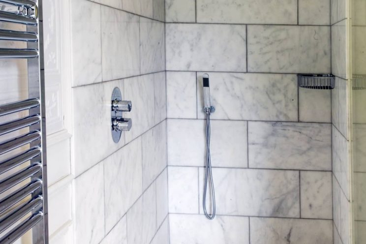 Marble style tiled walk in shower