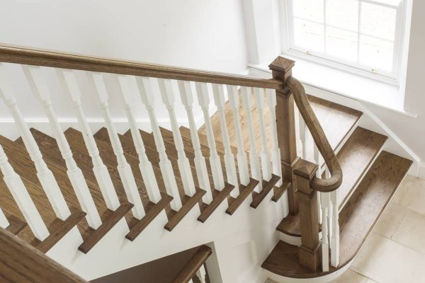 Curved oak staircase with banisters