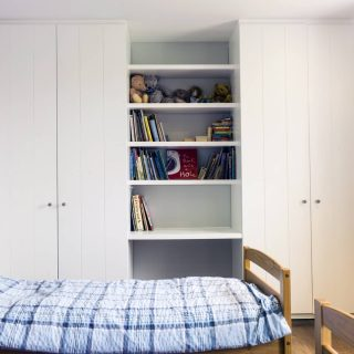 Simple white wardrobes in child's room