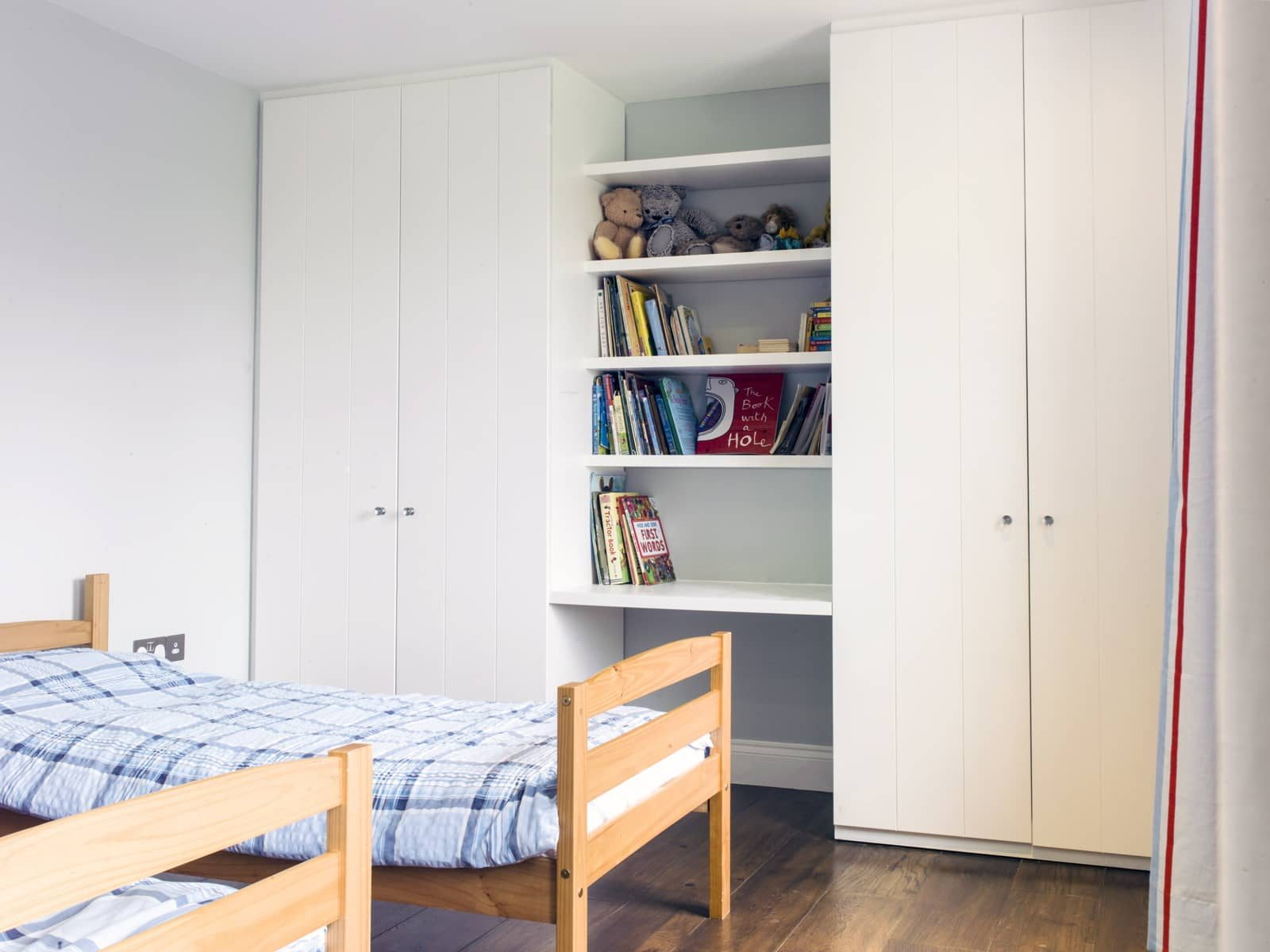 Fitted wardrobes in children's bedroom