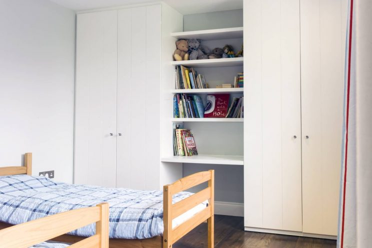 Twin fitted wardrobes in children's bedroom