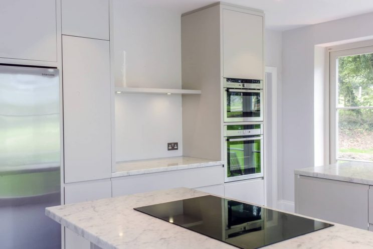 White modern kitchen with marble worktop