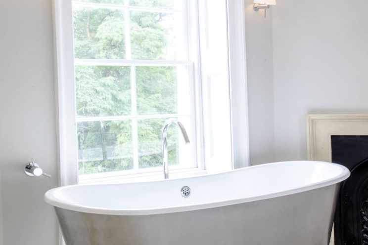 Modern bathroom with sash window in Bristol