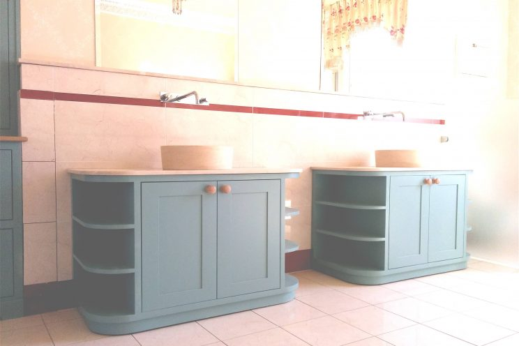 Twin green curved cabinets