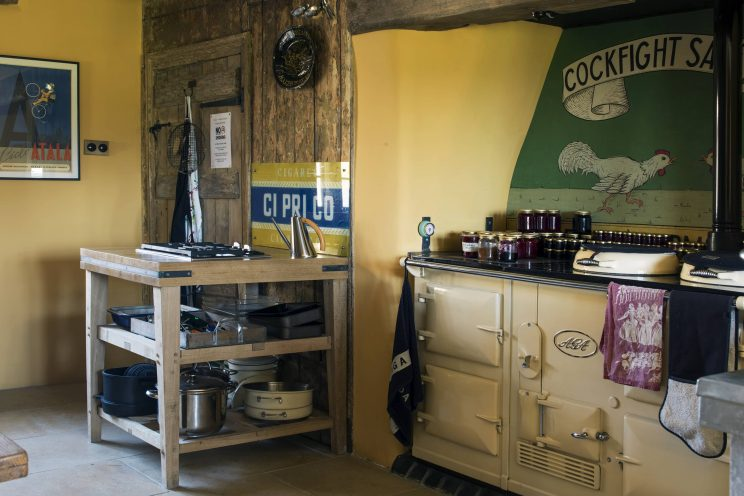 Large cream AGA in country rustic kitchen