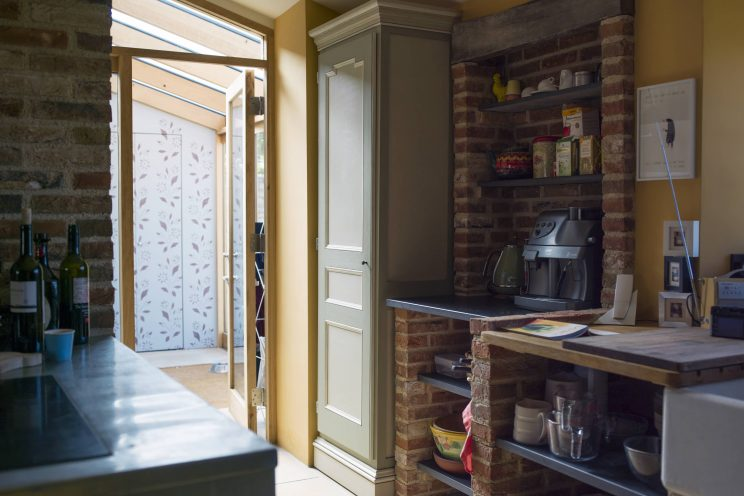 Shaker kitchen cupboard in a country home