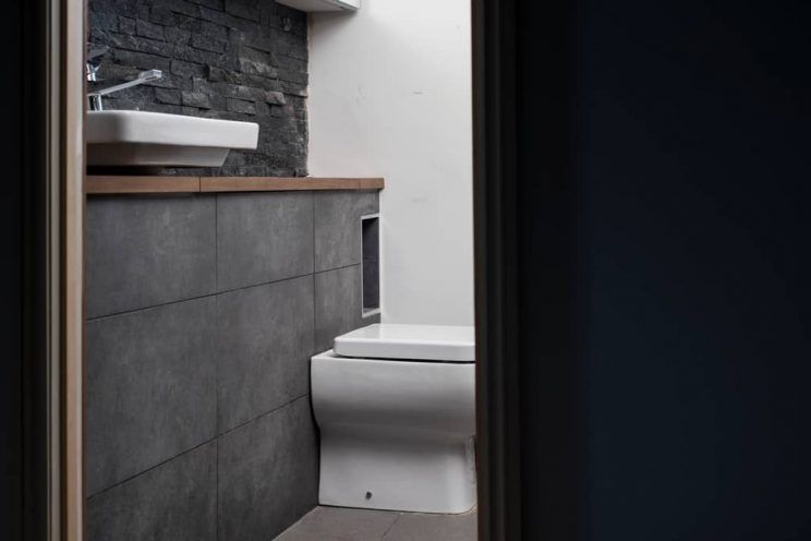 Modern slate tiled bathroom with ceramic white sink