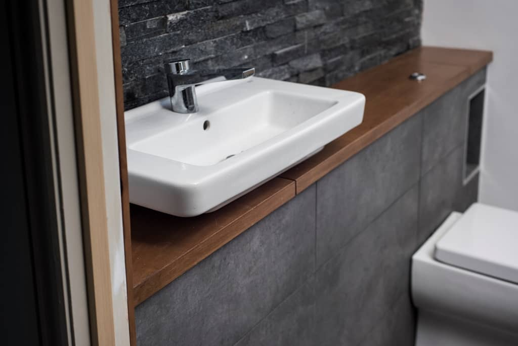 Slate tiled bathroom with ceramic white sink