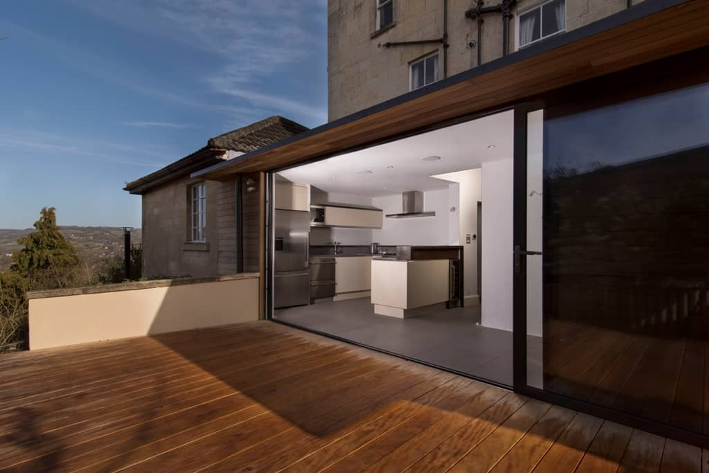 Wooden decking leading into contemporary kitchen in Bath