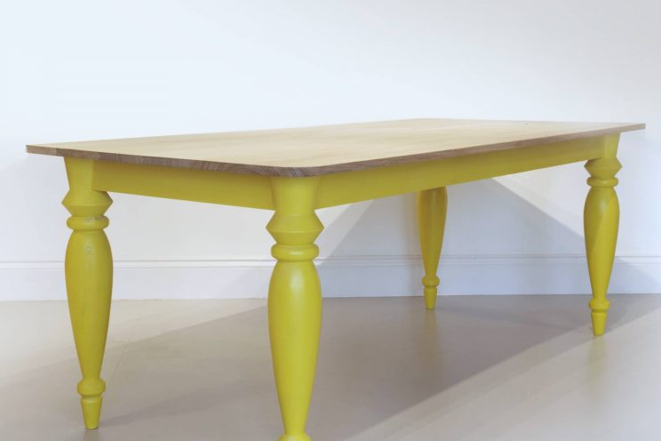 Contemporary kitchen table with yellow legs