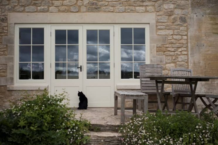 Cream french doors and windows in stone house