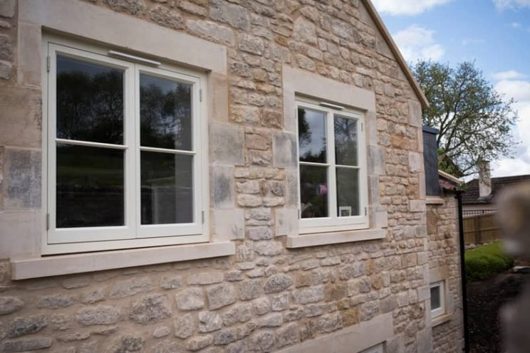 French style casement windows in modern stone house near Bath