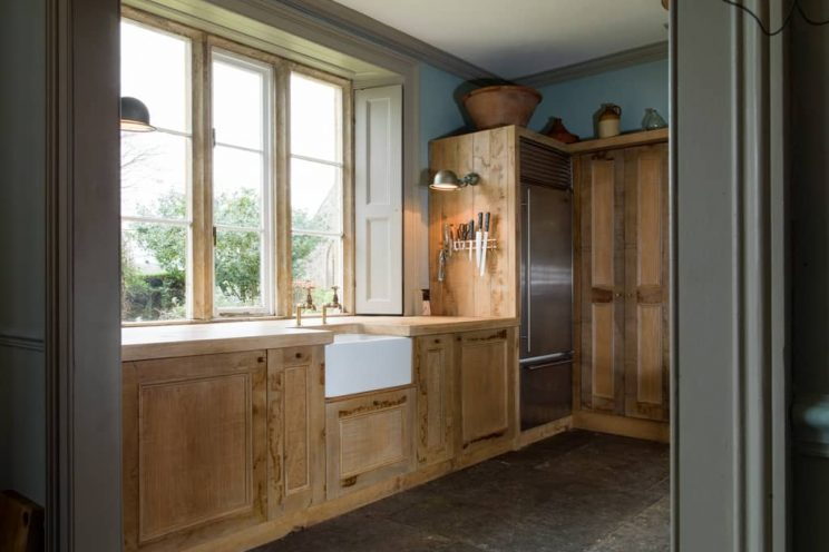 Rustic sustainable kitchen cabinets designed by Mia Marquez
