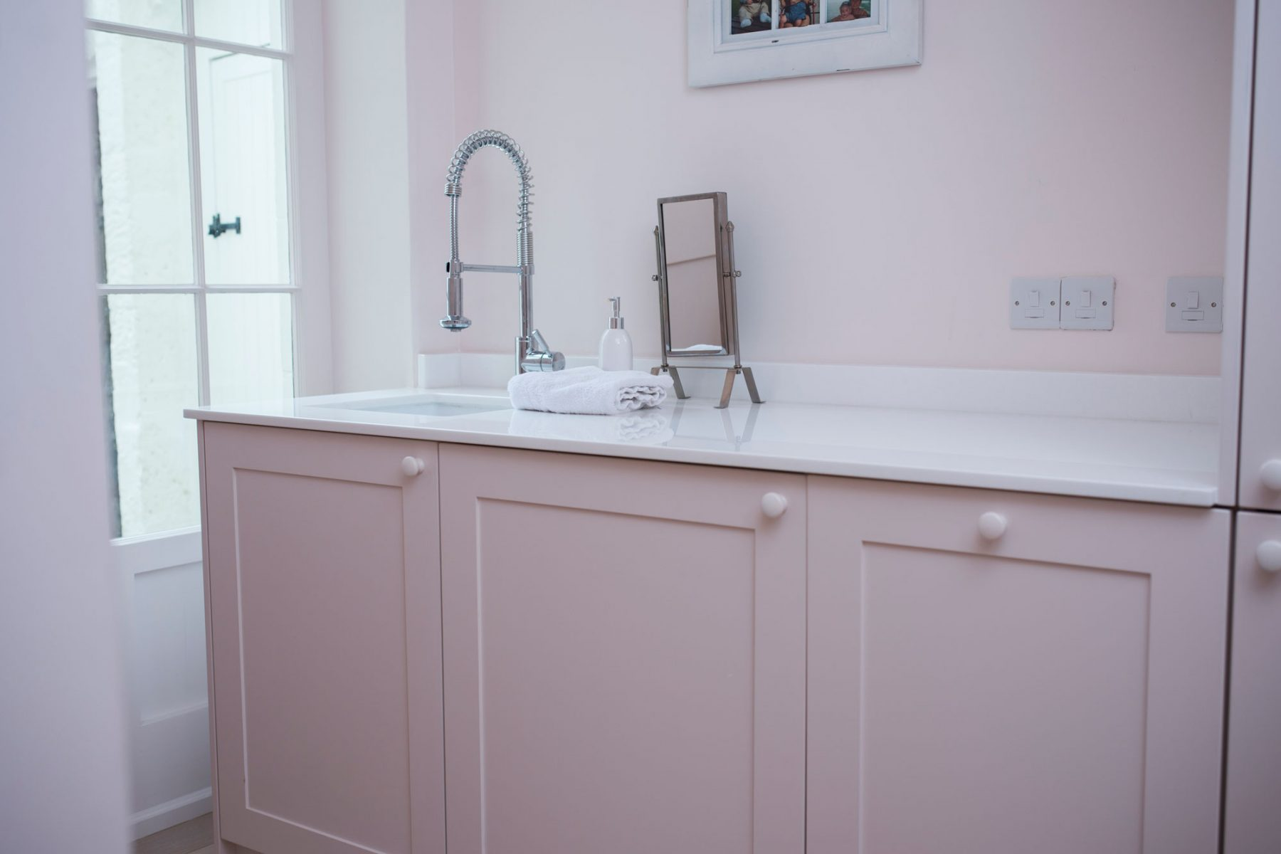 Elegant pink bathroom in Bath
