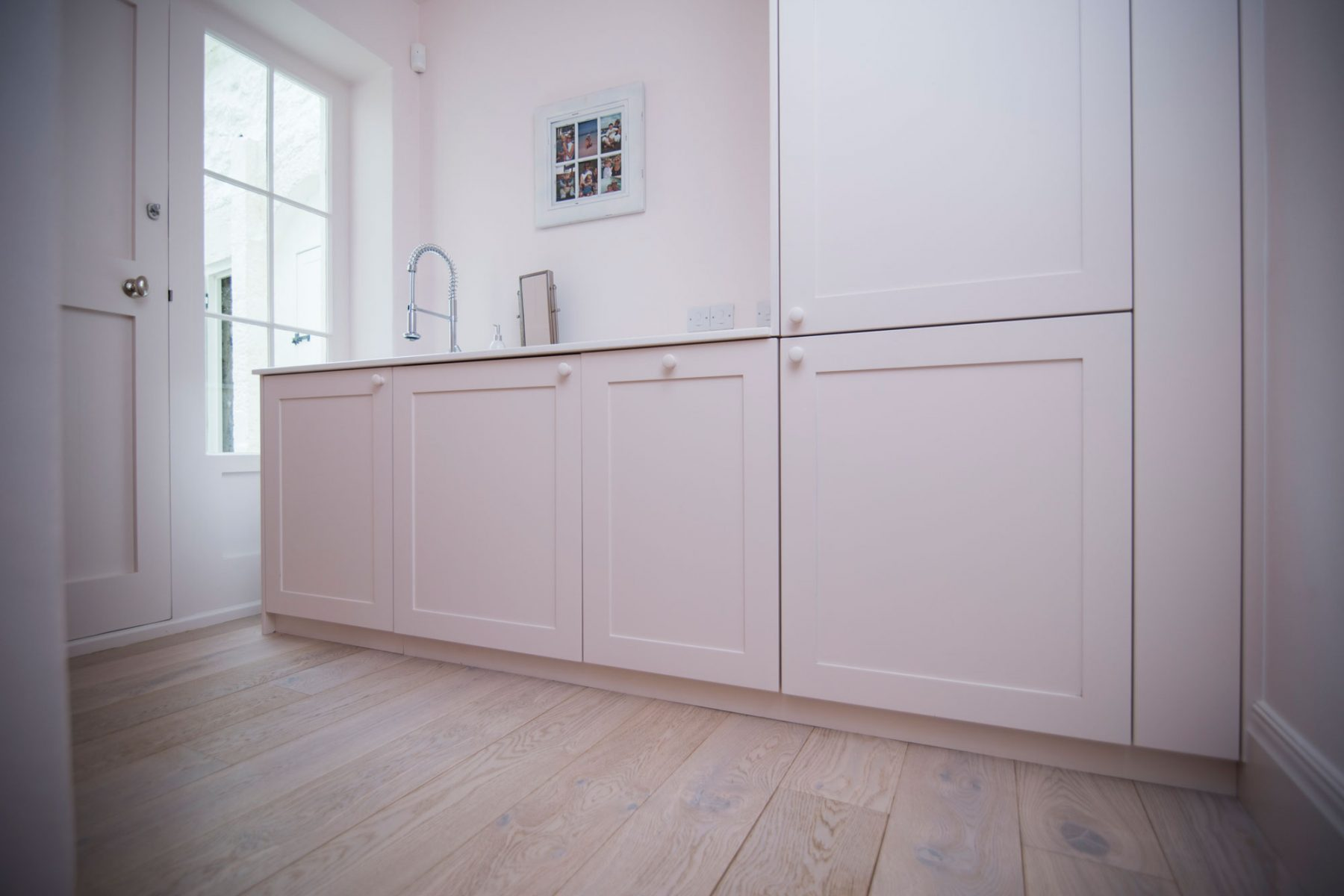 Modern utility room with wooden flooring
