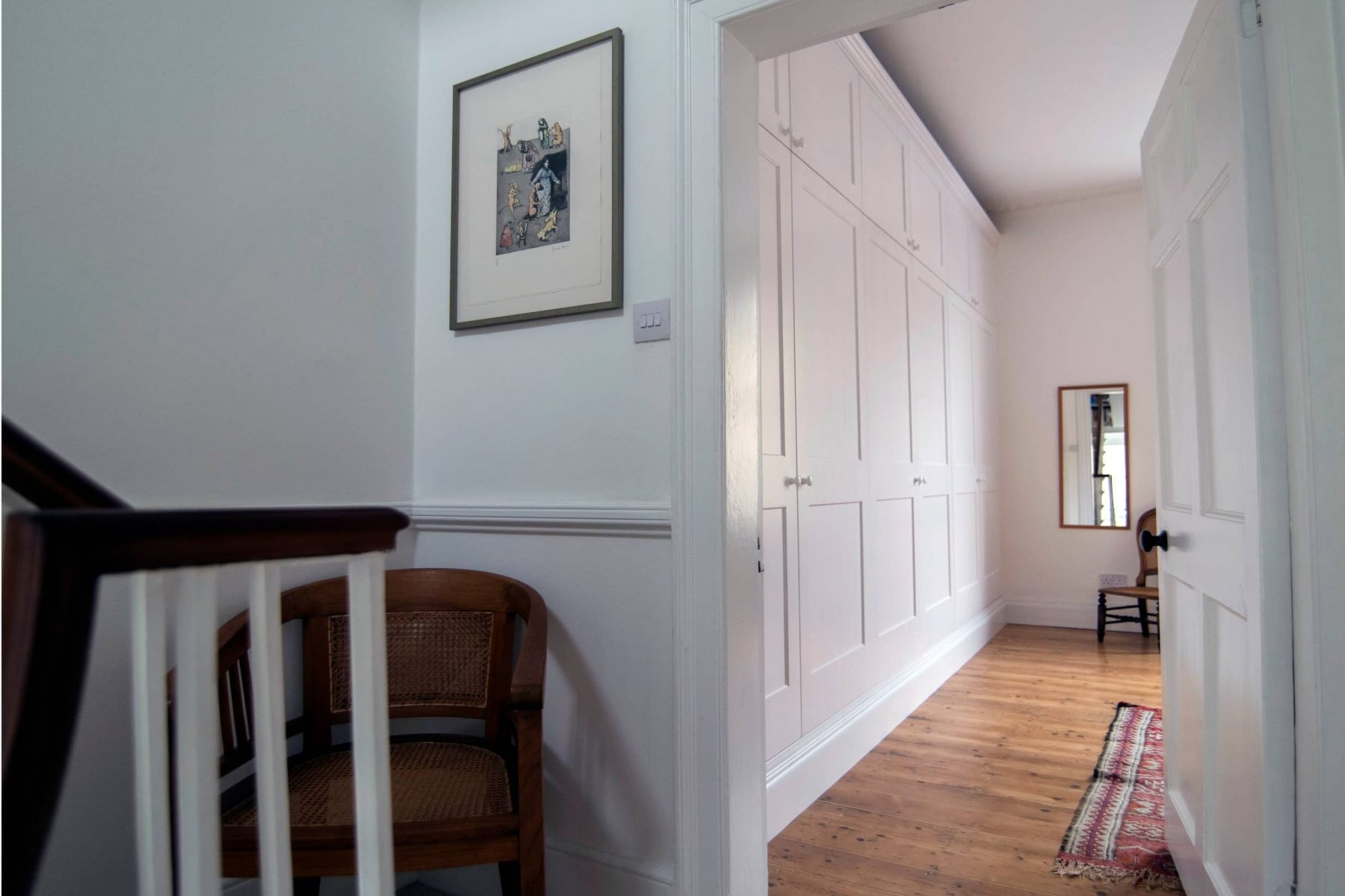 Fitted white wardrobes and office furniture Hallway to master bedroom