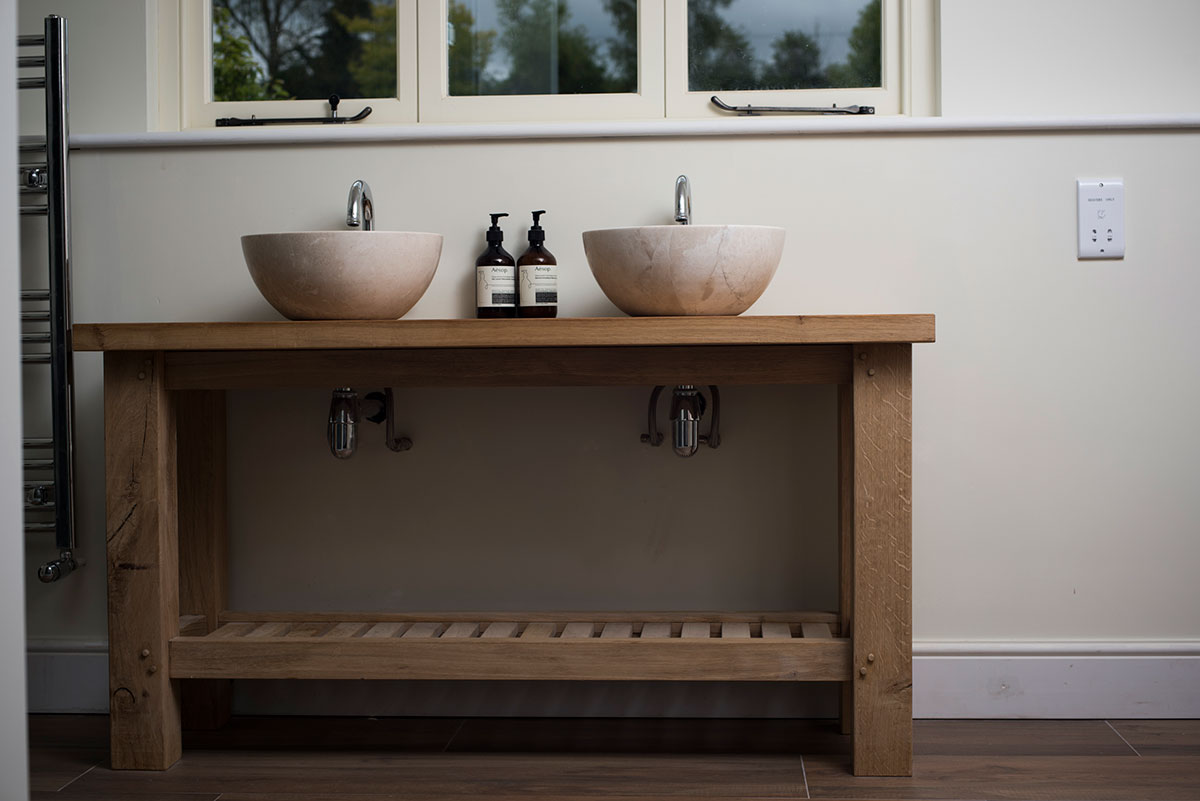 Oak vanity unit with pink marble basins