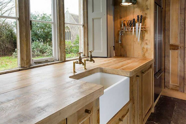 Rustic wood kitchen with white basin sink