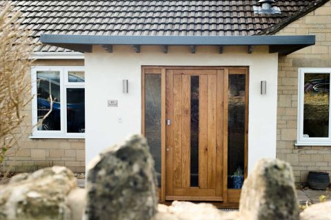 Wooden front door with glass
