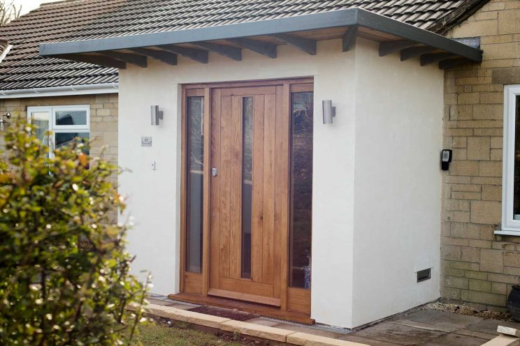 Wooden front door with glazed panels