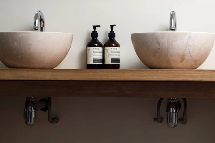 Bespoke oak bathroom sink unit with marble basins
