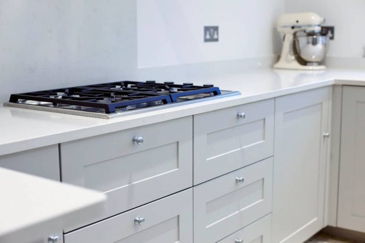 Contemporary grey shaker kitchen with gas hob