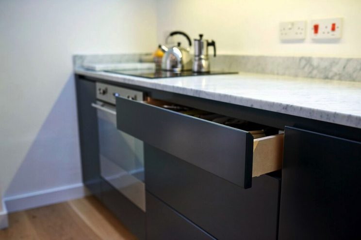 Contemporary dark grey kitchen with soft close drawer