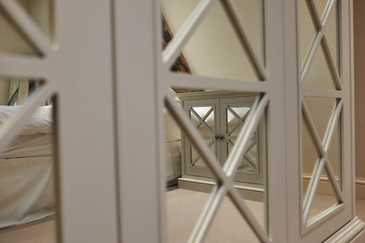 Mirror finished fitted wardrobe with art deco design