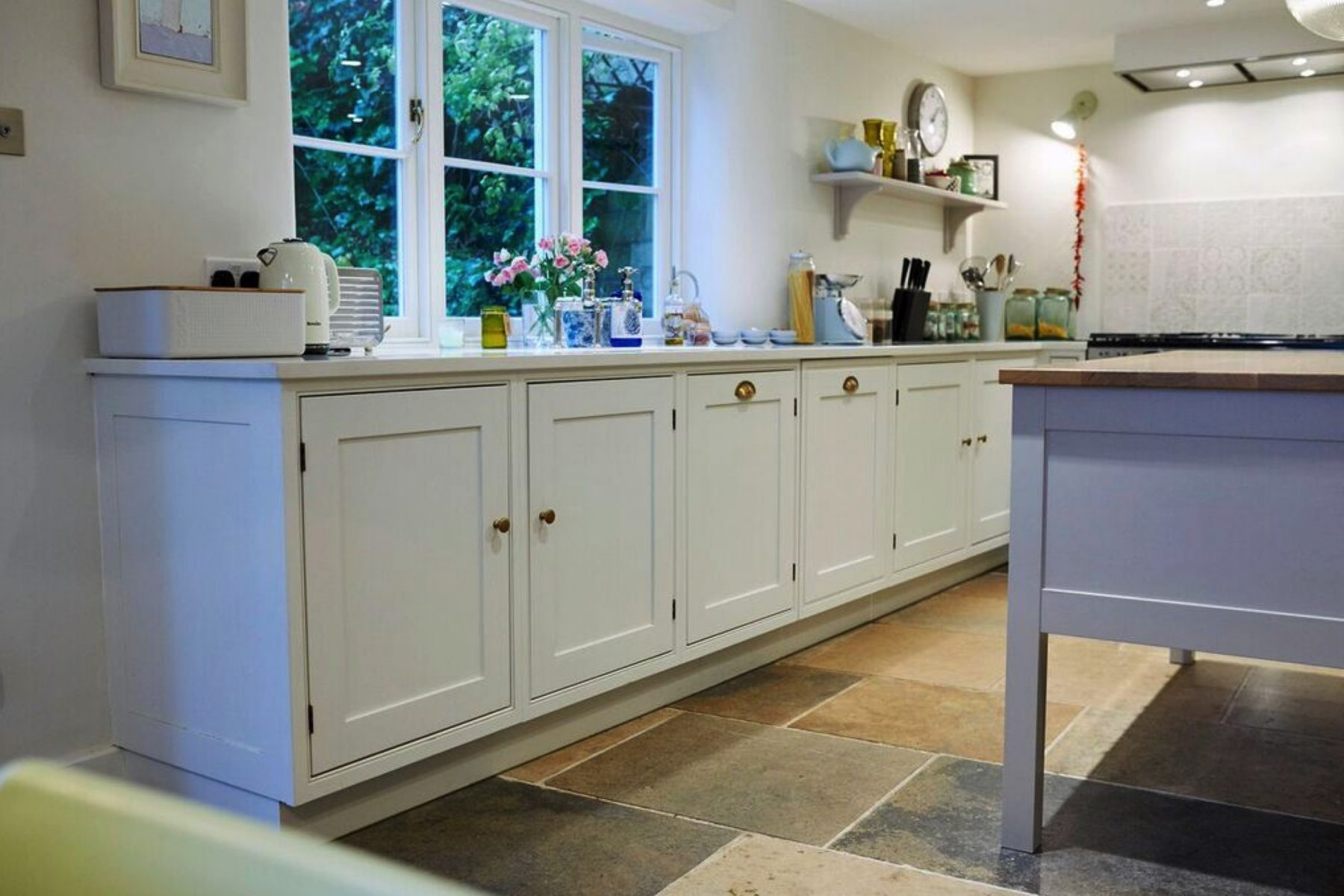 Cream classic kitchen with brass handles
