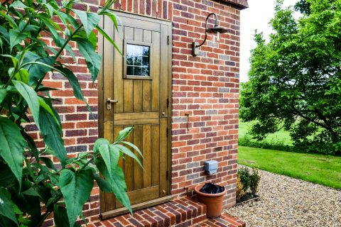 Wooden exterior door with a yellow stain finish