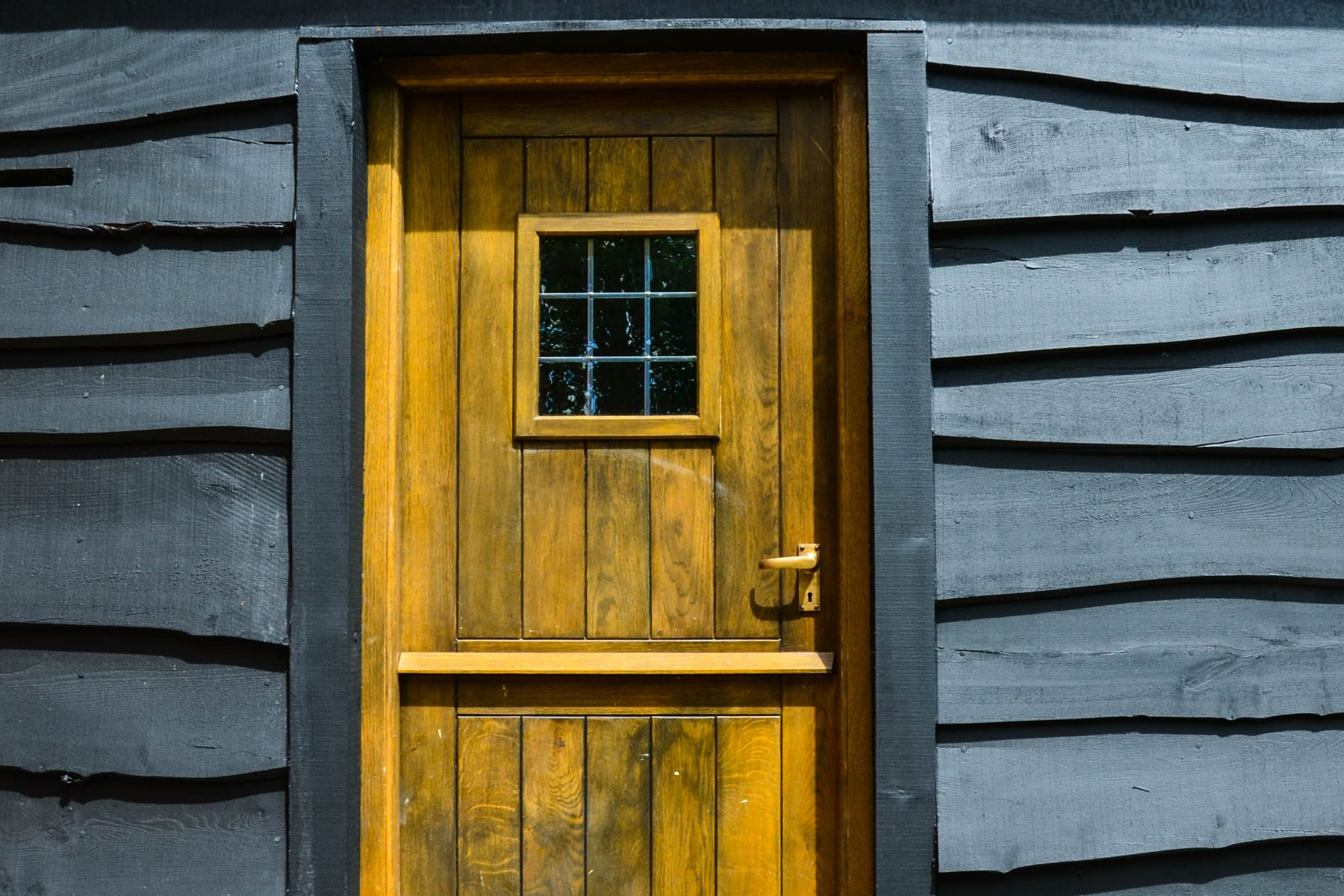Yellow stained stable timber door