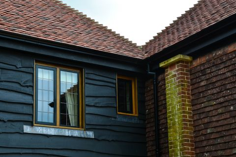 Black casement windows in Tudor style house