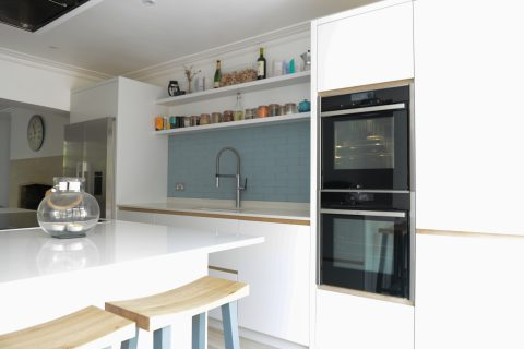 Twin inbuilt cooker with white kitchen island