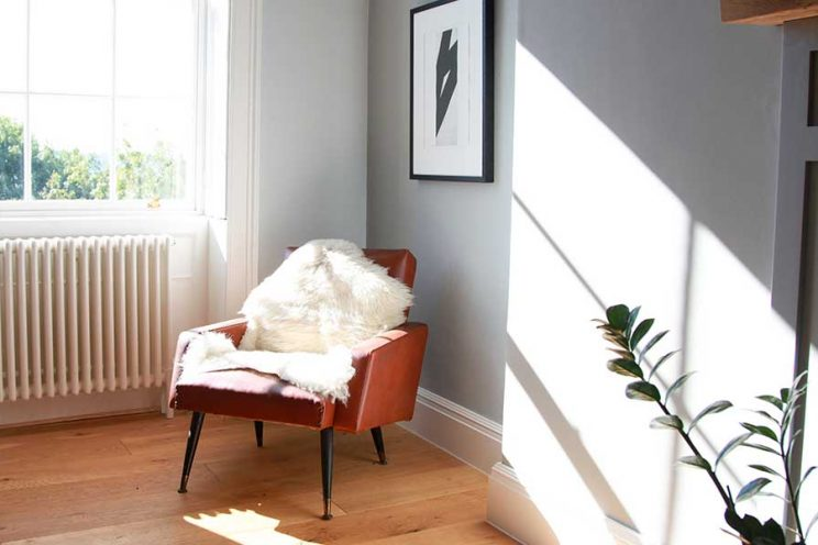 Red arm chair with sheepskin throw