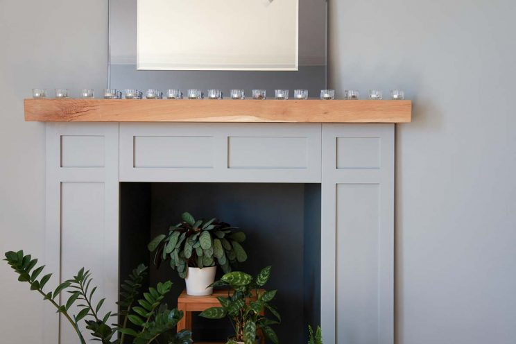Contemporary wooden fireplace in light grey