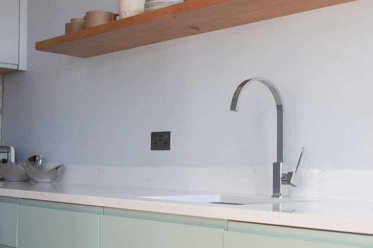 Curved stainless steel taps with Silestone Snowy Ibiza counter top