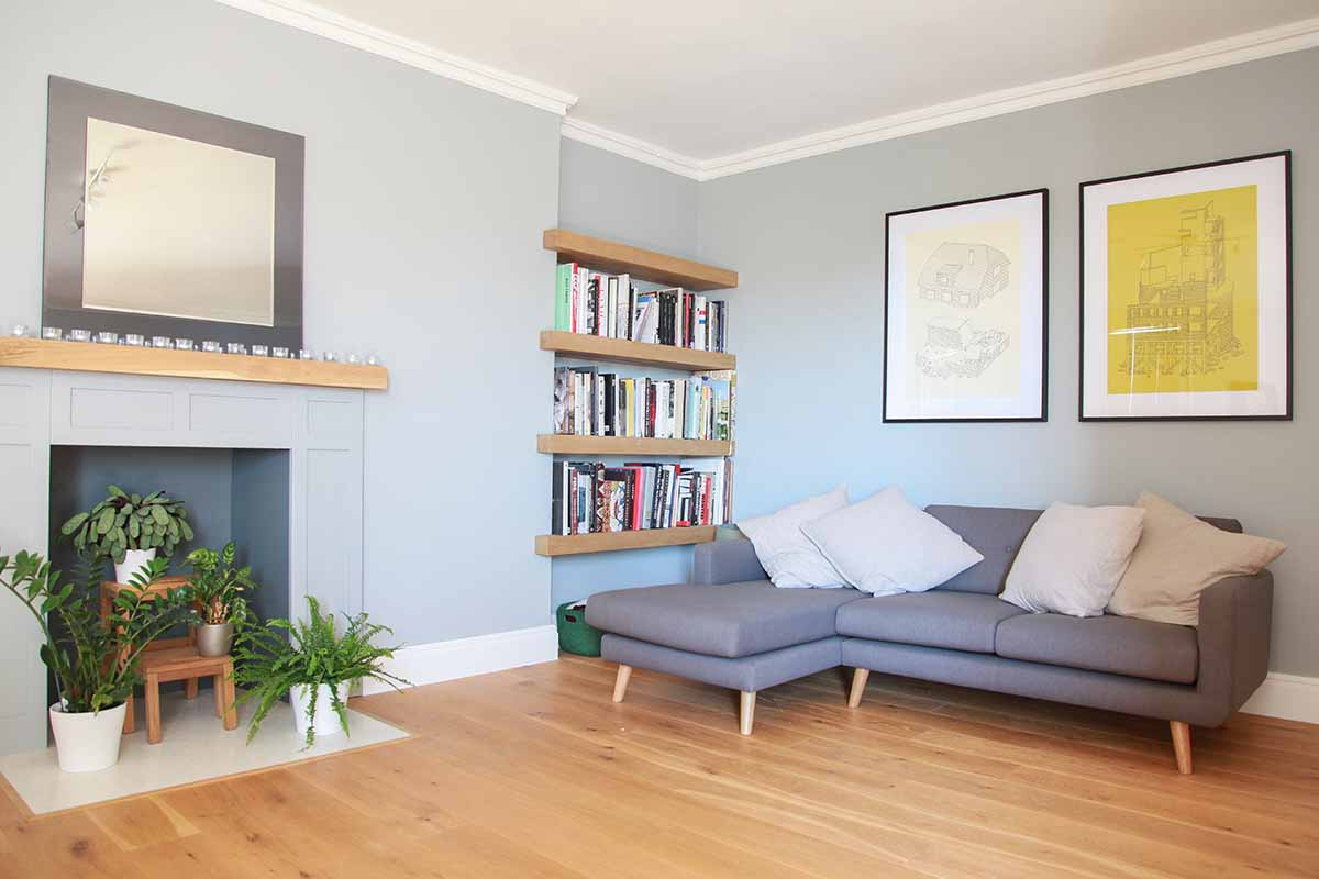 Light grey living room with L shaped sofa and fireplace