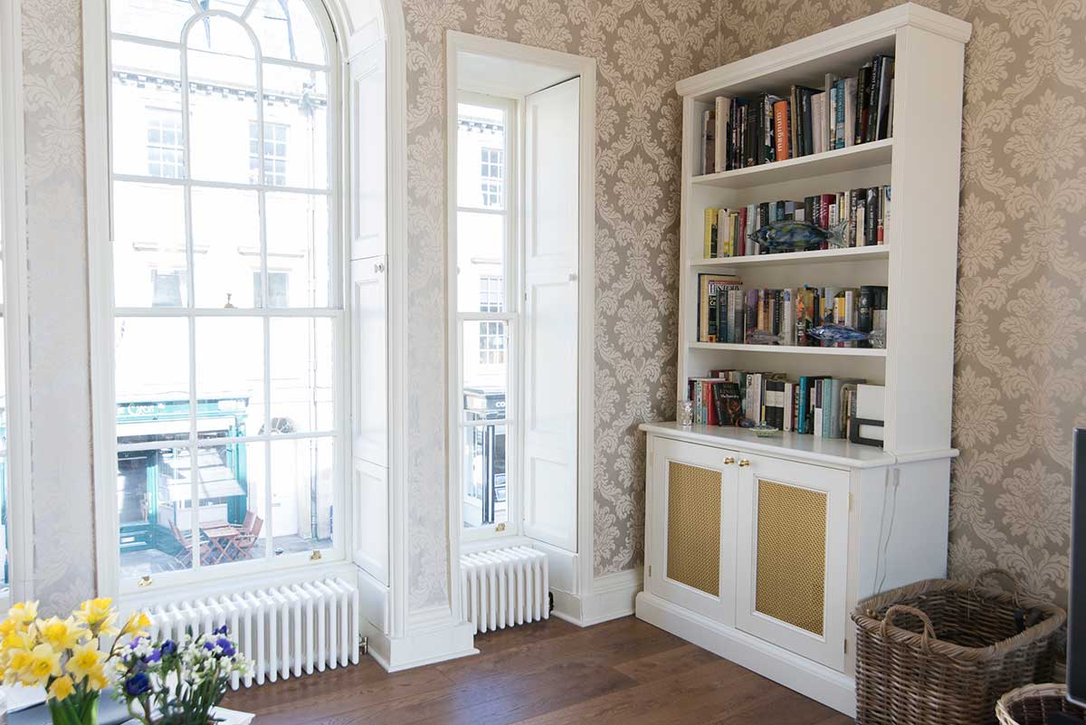 Custom-made white cabinets with bookshelves