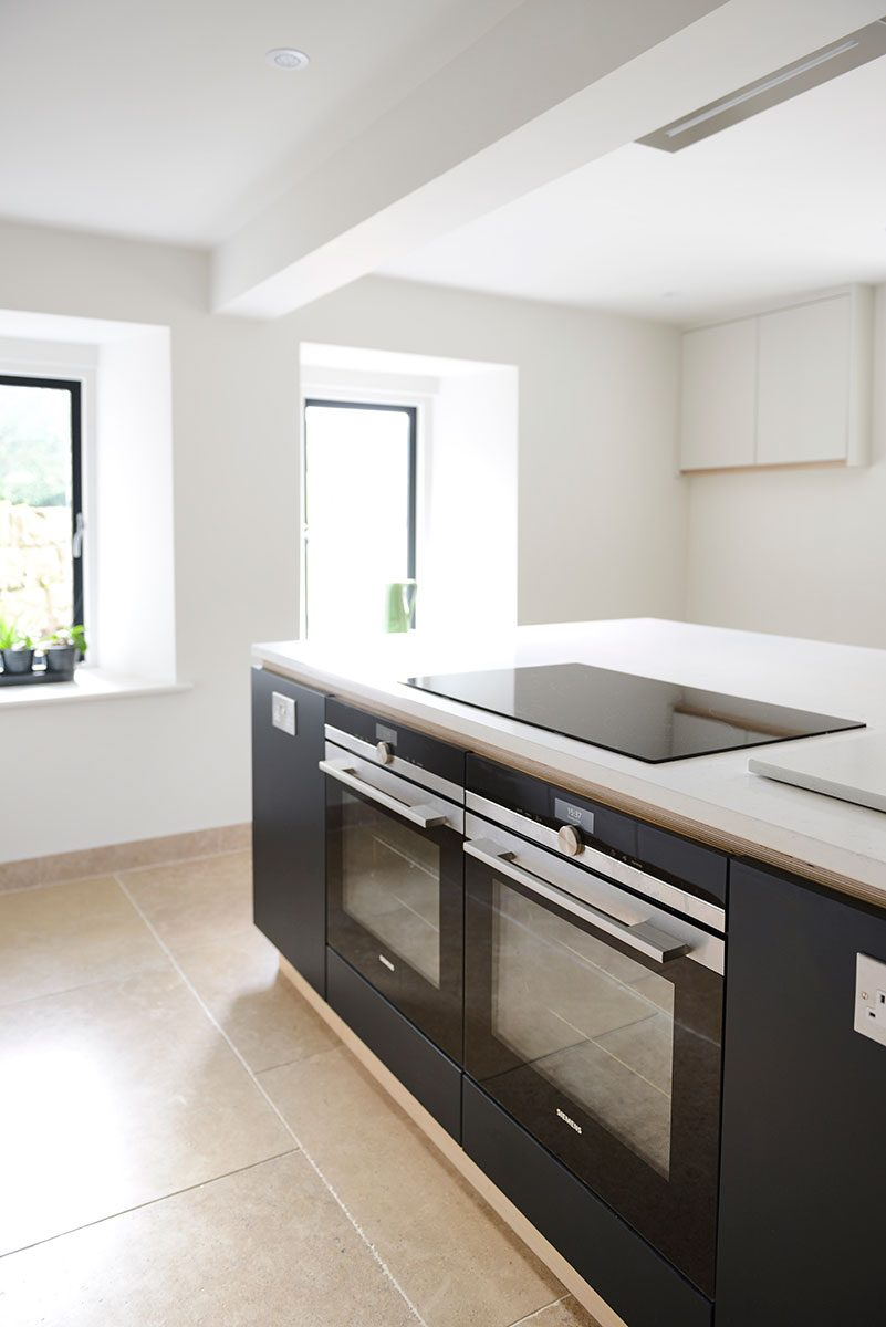 Contemporary kitchen with twin cooker with Snowy Ibiza Silestone kitchen counter top