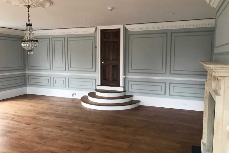 Cleveland House. Ballroom style room featuring bespoke hardwood doors, steps and wall panelling.