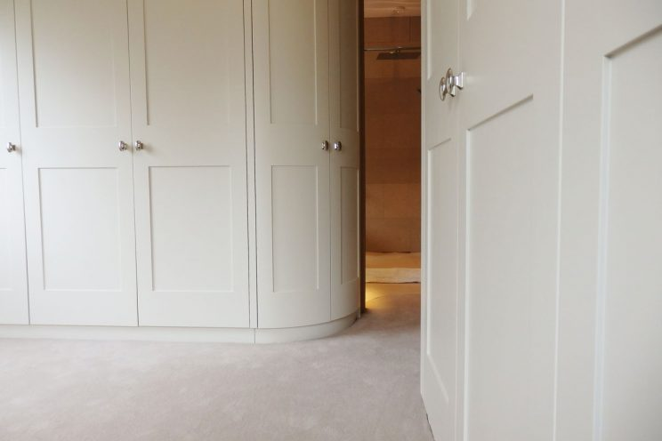 Curved white wardrobes